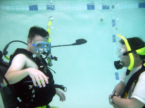 Open Water scuba student practicing skills with an open water scuba instructor