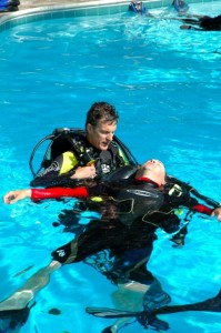 Rescue divers practicing how to respond to a scuba emergency: assisting an unresponsive, non-breathing diver at the surface.