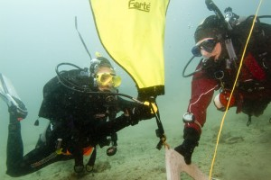 Search and Recovery divers using a lift bag to raise an object as part of their track towards Master Scuba Diver