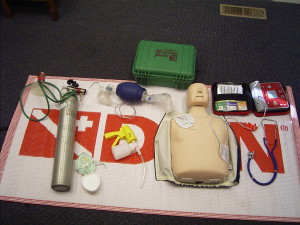 Divers Alert Network Instructor tools: manikin, aed, oxygen, suction, bag valve mask and pocket mask