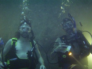 Two scuba divers enjoying the Hot Spring Diver experience at the Homestead Crater